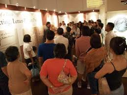 Group of people taking a museum tour.